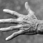Black and white photo of a man's hand