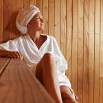 A woman sitting in a sauna