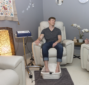 A Vitality patient undergoing ionic foot bath therapy.